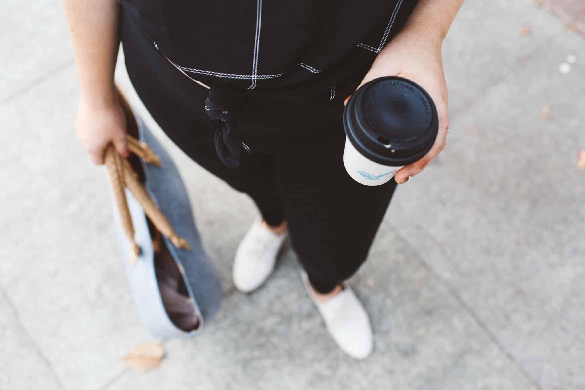 holding coffee