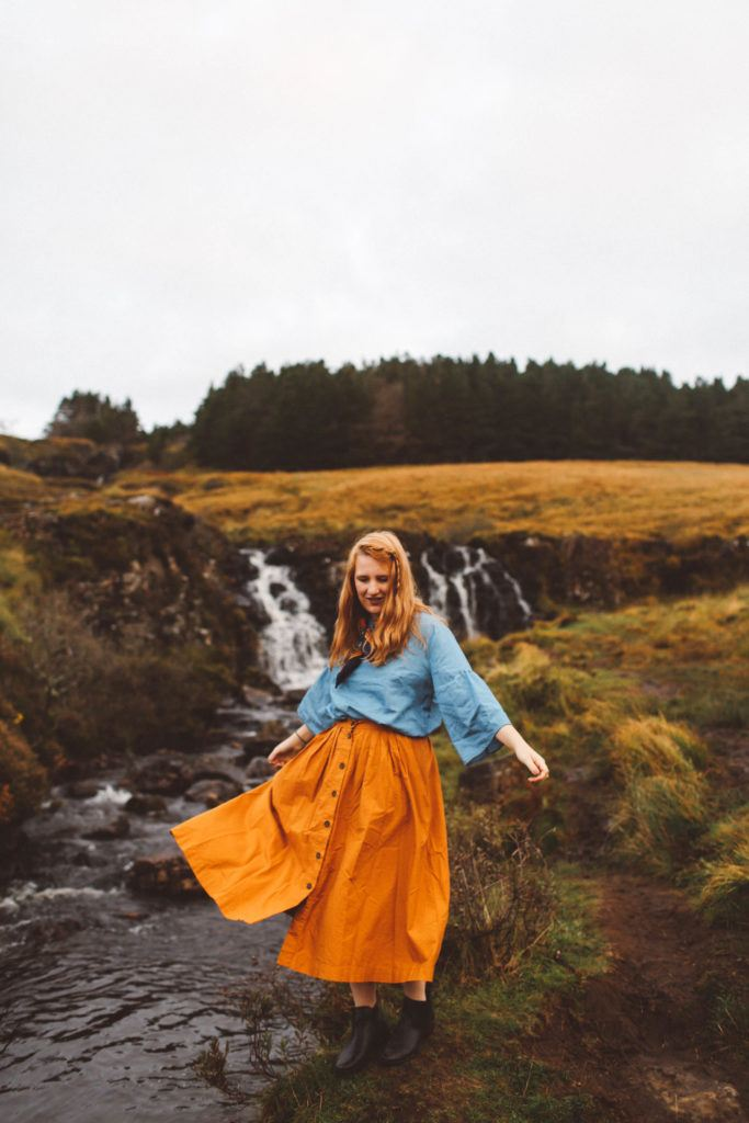 fairy pools isle of skye orange skirt woman