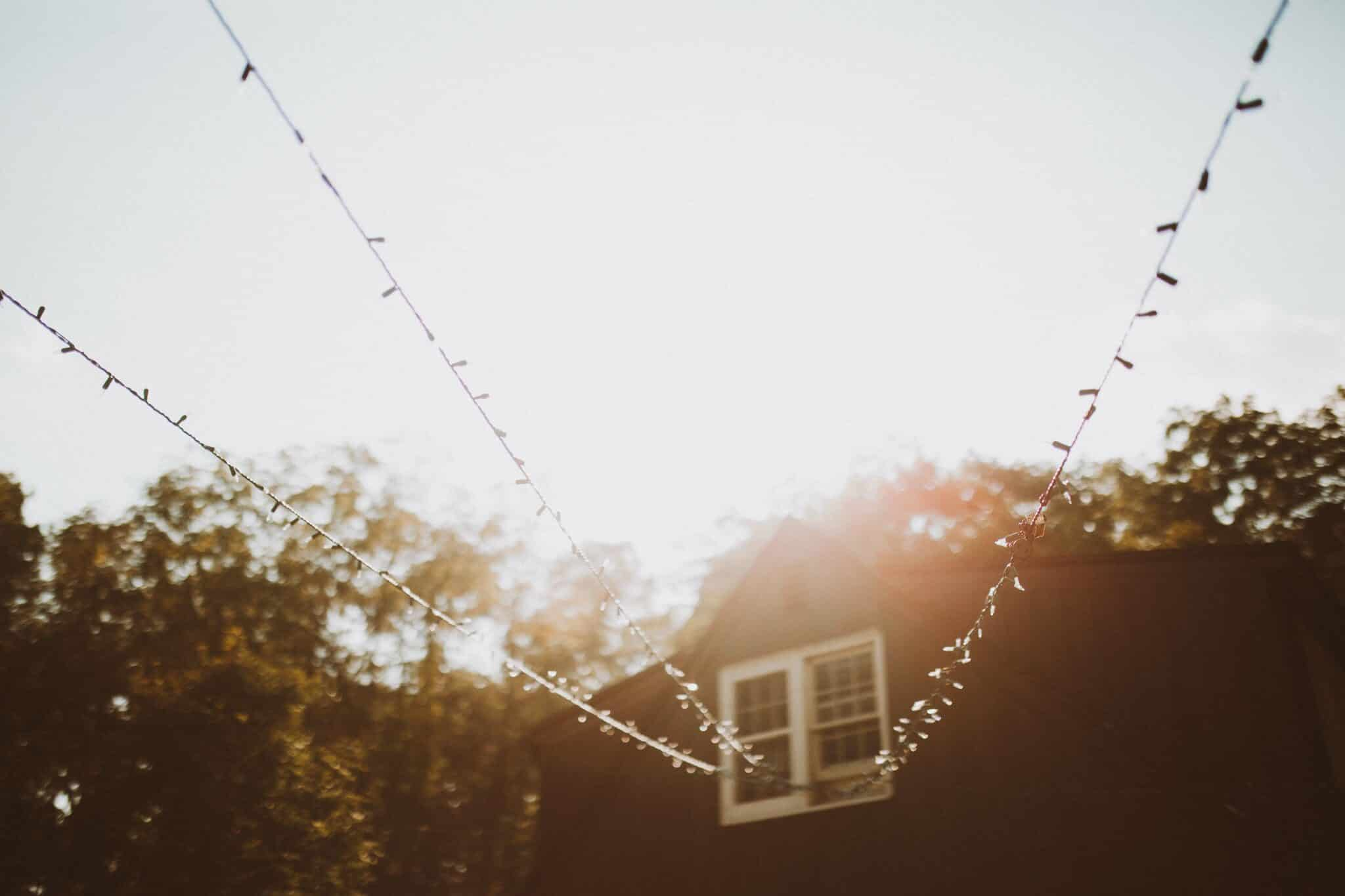 wedding string lights golden hour house
