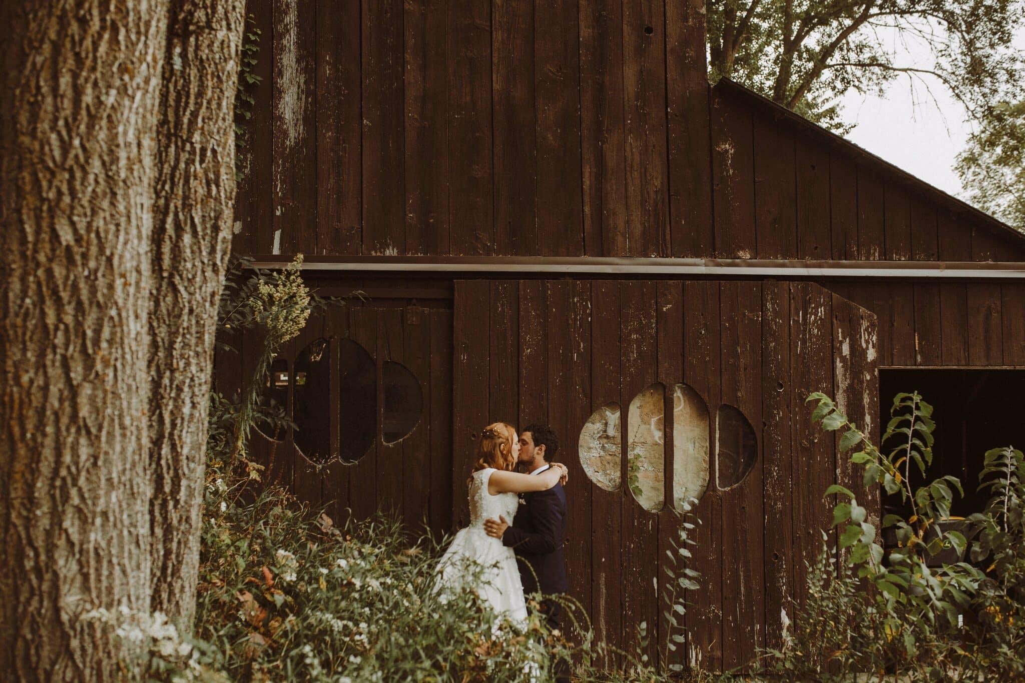 wedding bride groom portrait barn boho