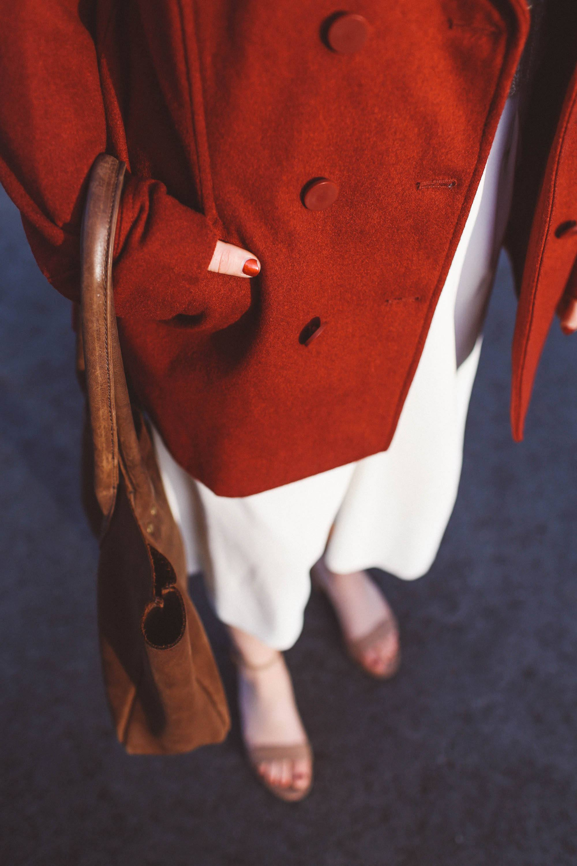 red coat brown purse